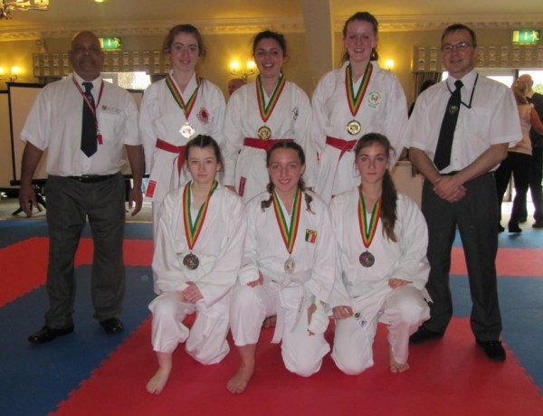 Laura Browne and Elaine Dullaghan take gold with their team mate in team kumite