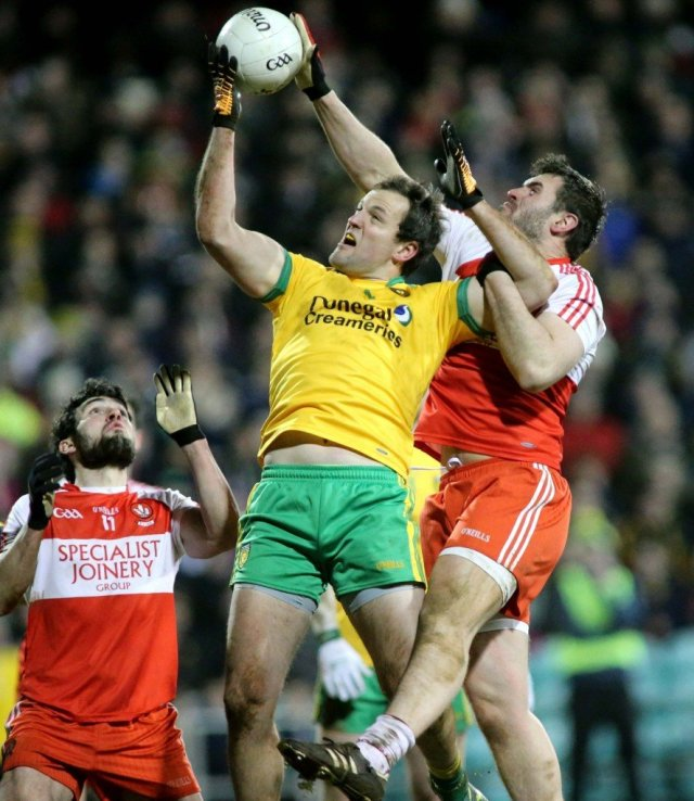 Michael Murphy wins this aerial dual during Donegal's win over Derry.