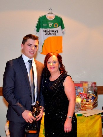 Maggie Mc Daid of the Sandwich Company presents Young player of the year to Oisin Crawford at the Glenswilly Dinner Dance.  Photos: Geraldine Diver