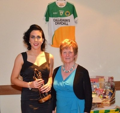 Kathleen Callaghan of Callaghan's Bar presents Claire Bohan with the Ladies team player of the year award.