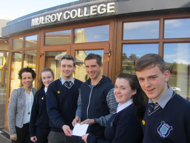 Head boy, Gavin Alcorn Friel and Head girl Niamh Boyle making a presentation to Brendan along with Principal Fiona Temple. Also pictured are the Deputy Head boy, Patrick Mc Conigley and Deputy Head girl, Mariosa Friel.