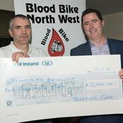 Marty presents Bernard with a cheque for an incredible €5,000 for Blood Bikes North-West.