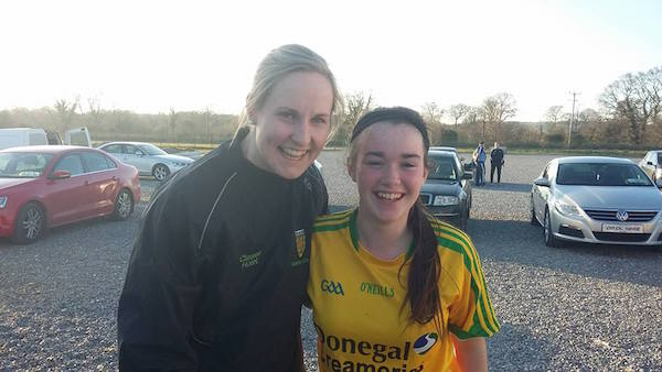 Senior Ladies player Karen Guthrie congratulating the U14 Joint Captain Ellie Barron (St Mary's Convoy) on her 14th birthday today