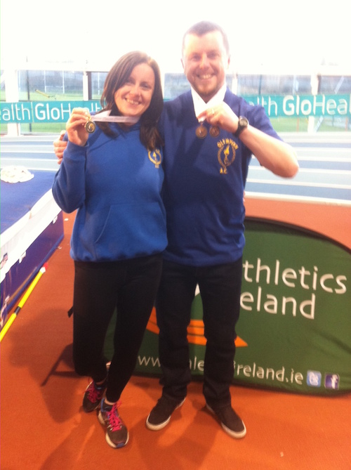 Karen and Martin celebrate with their medals.