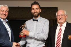 Jimmy Bradley receives the top goal scorer of the year from Leonard Watson at the Ulster Senior League presentations pictured with Chairman Johnny Mc Cafferty.