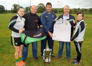 Geraldine McLaughlin (Donegal Ladies Captian), Micheal Naughton (Donegal Ladies Manager) and Marie McColgan (Donegal Ladies Mentor), accepting the generous sponsorship of Kit Bags from Ivan Harvey, Micad Security, and Tracksuits from John Watson, Watson Hire.
