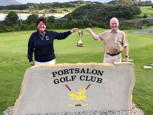 This image has an empty alt attribute; its file name is Society-Captain-Ms-Deirdre-O-Toole-presents-Tommy-Greally-with-his-trophy-as-Donegal-ETB-Golf-Society-Golfer-of-the-Year.jpg