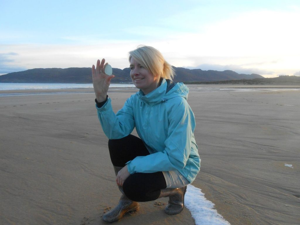 Helen Haworth collecting another fine piece of seaglass from the beach at Portsalon.