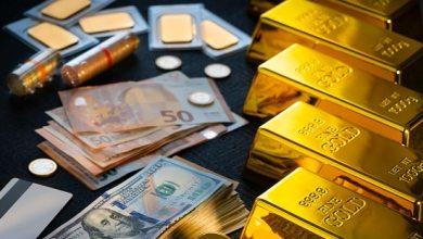 نتيجة لقوة الدولار هبط الذهب إلى أدنى مستوى له في أكثر من 8 أشهر