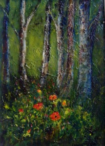 Poppies in woodland among the trees