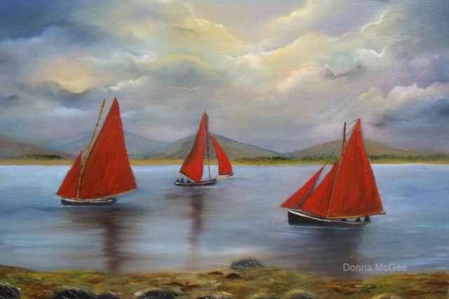 Galway Hookers, boating off the west coast of ireland, red sails in the sunset,