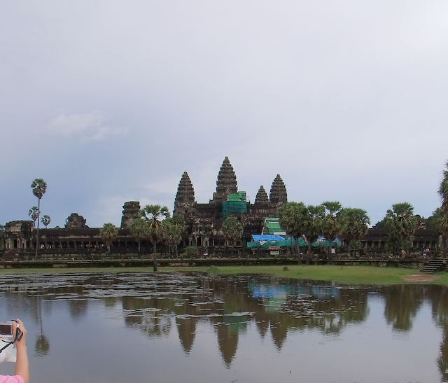 Angkor Wat (Wat temple) is the central feature of the Angkor UNESCO World Heritage Site containing the magnificent remains of the Khmer civilization. Angkor Wat's rising series of five towers culminates in an impressive central tower that symbolizes mythical Mount Meru. Thousands of feet of wall space are covered with intricate carving depicting scenes from Hindu mythology.
