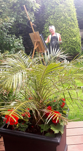 Donna McGee Painting in the Garden