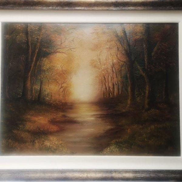 Golden moments in bespoke frame depicting woodland scene