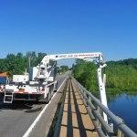 Under Bridge Inspection Unit inspecting bridge