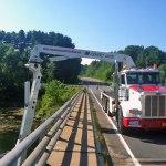 Under Bridge Inspection Unit truck with boom arm under bridge