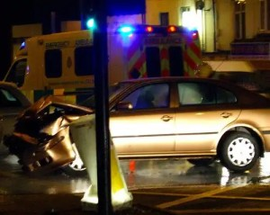 Picture of a car and ambulance after a road accident