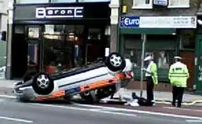 Photo of a police car road accident which may have led to a police misconduct investigation.