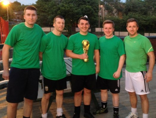 "Picture of Donoghue Solicitors' ""World Cup"" winning 5-a-side football team."