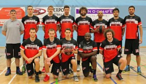 Photo of Donoghue Solicitors sponsor sign with the Liverpool Basketball Club Men's Team in their training kits.