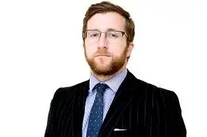 Picture of Kevin Donoghue, solicitor, who discusses how police Tasers threaten public confidence.