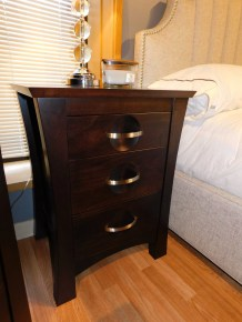 """Procidence 3-Drawer Nightstand Wood Species Shown: Brown Maple Dimensions: 23""""W x 19""""D x 30.5""""H Price As Shown*: $885 Fully Customizable. *Price of piece not inclusive of current sales. Please see our Pricing page for more details."""