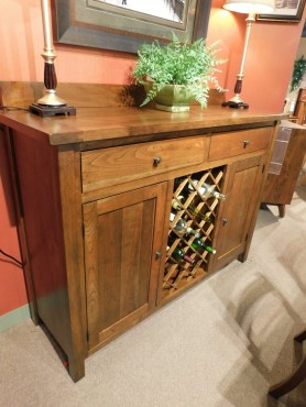 "Plank Top Buffet with Open Wine Storage Wood Species Shown: Rustic Cherry Dimensions: 61""W x 19""D x 48""H Price As Shown*: $2,238 Fully Customizable. *Price of piece not inclusive of current sales. Please see our Pricing page for more details."
