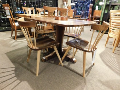"""Vilas Single Pedestal Table Vilas Solid Top Single Pedestal Table Wood Species Shown: Sap Walnut Dimensions: 36""""W x 48""""L Fully Customizable. Bradford Side Chair Wood Species Shown: Rustic Walnut / Ash Partially Customizable. Please contact us for pricing details."""