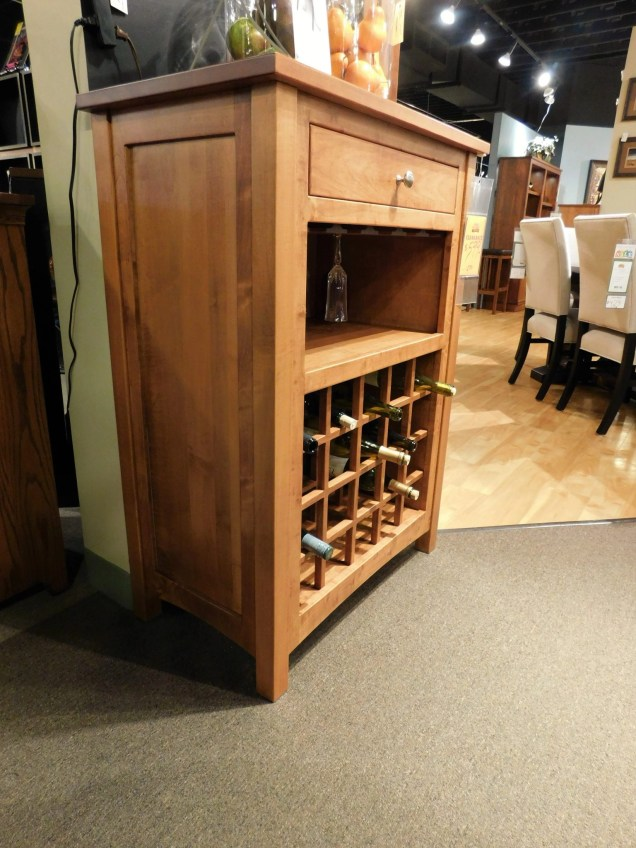 "Noble Wine Cabinet with Drawer on Top Wood Species Shown: Brown Maple Dimensions: 31""W x 18""D x 43""H Price As Shown*: $1,270 Fully Customizable. *Price of piece not inclusive of current sales. Please see our Pricing page for more details."