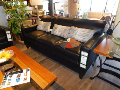 Essentially Yours Sofa - No Buttons, with Angled Arm Fabric Shown: Revelation Midnight Leather Pillow Fabric: #1284 Deco Black Pearl with Buttons Price As Shown*: $4,175 Partially Customizable. *Price of piece not inclusive of current sales. Please see our Pricing page for more details.