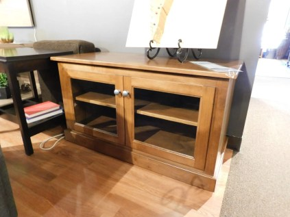 """TV Stand with Glass Doors Wood Species Shown: Brown Maple Dimensions: 40""""W x 18""""D x 22""""H Fully Customizable. Please contact us for pricing details."""