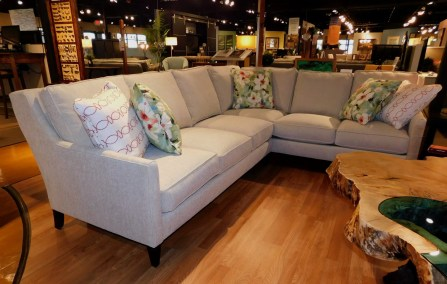 Andee 2-Piece Sectional Sofa with Pillows Fabric Shown: Grade N #12754-28 Stain Shown: Chocolate [Feet] Partially Customizable. Please contact us for pricing details.