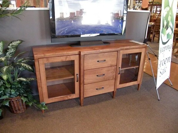 Offset TV Stand #2061 Kidron Wood Species Shown: Brown Maple Fully Customizable. Please contact us for pricing details.