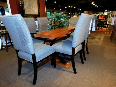 """Union Square Slab Top Table with Inset Glass and Metal X-Base with 6""""x6"""" Wood Beam Wood Species Shown: Rustic Cherry Special Feature: Live Edge, Clear Filled Knots Dimensions: 42""""W x 84""""L x 31""""H Shown with Cosmo Chairs. Fully Customizable. Please contact us for pricing details."""