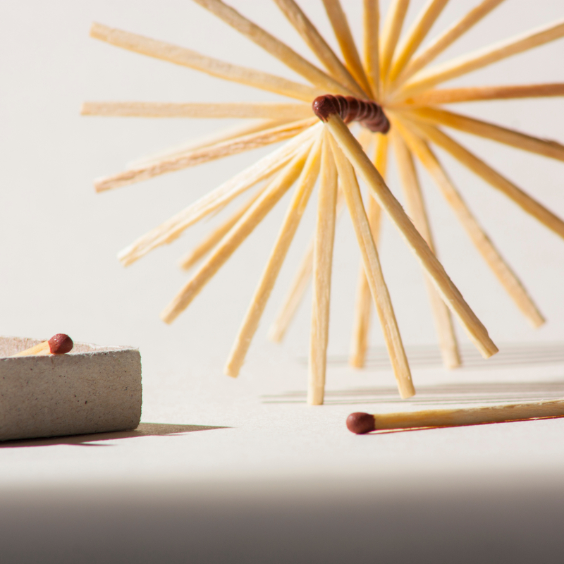 An array of matches shaped like a pinwheel