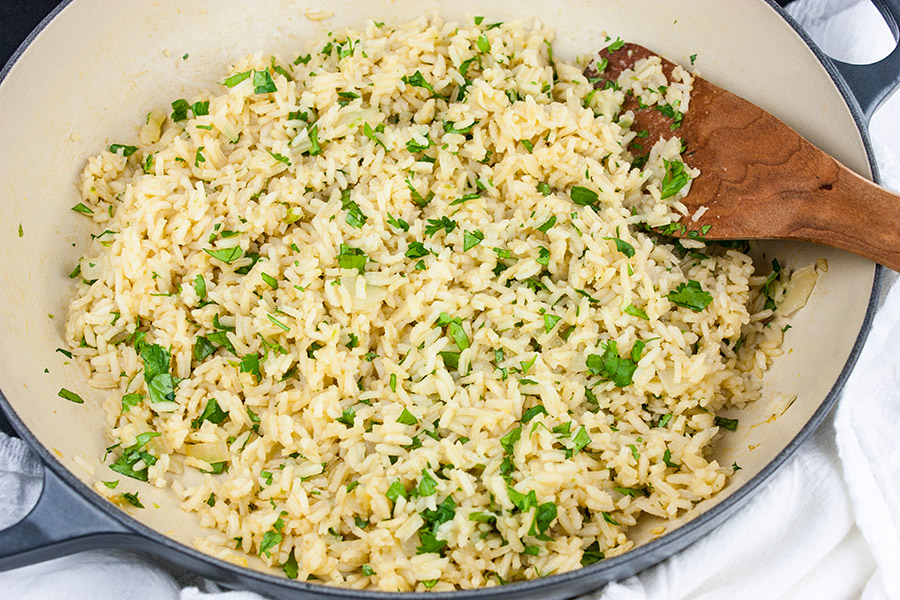 Cilantro Lime Rice - Perfect with any Mexican inspired menu! A few simple ingredients take boring white rice to a new flavor-packed level. A great side dish with pork, chicken, fish, or beef.