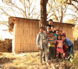 Thangpalkot kids and Jayjeev in front of the shed.