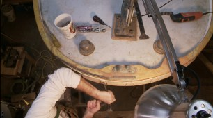 Hammering out screw on rubrail
