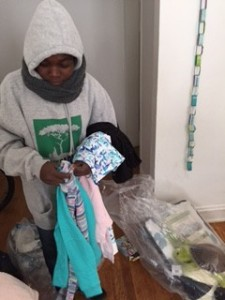 A recipient with a donated Save Darfur sweatshirt, beginning life in the US.