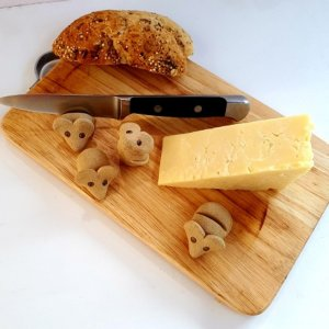 Pottery mice on cheeseboard