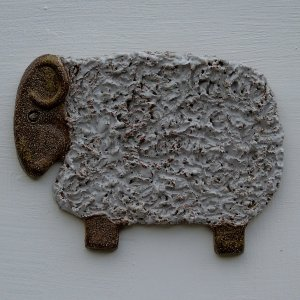 Pottery sheep wall motif