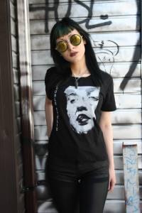 Lovina models a Double Eyelid t-shirt.