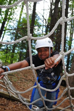camper resting on high ropes course