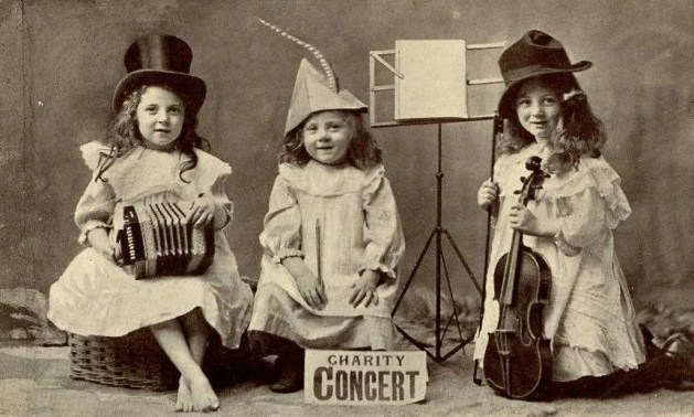 Three you ladies with a concertina, tin whistle, and a violin.