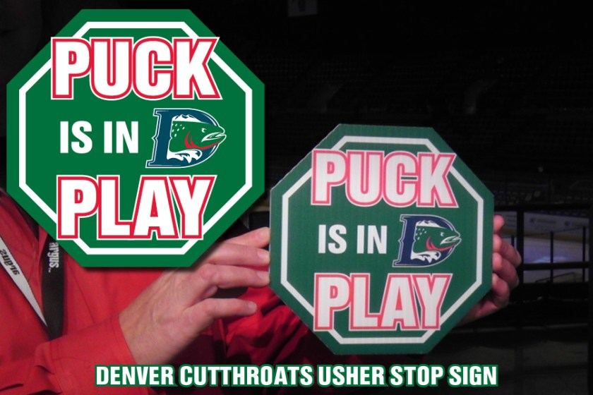 """Puck is in Play"" signage used by ushers inside the Denver Coliseum for the Denver Cutthroats home games."