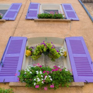 Lavender coloured shutters on a building in Provence.