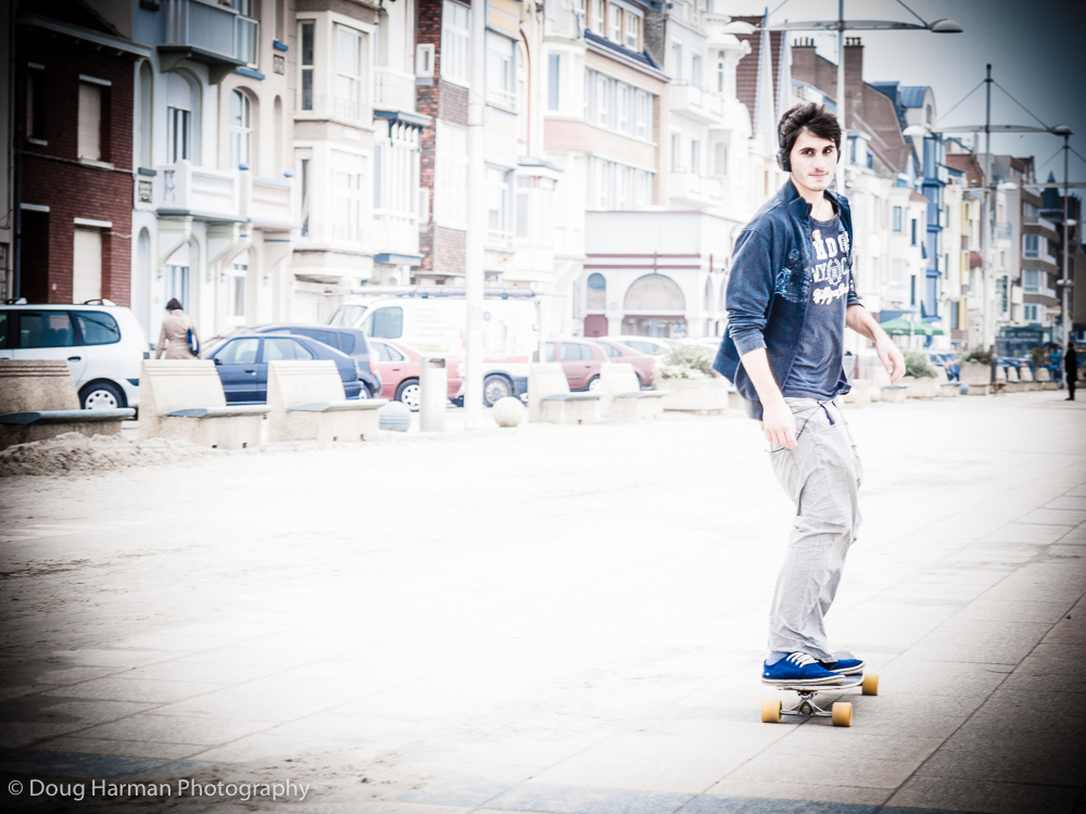 Skateboarder, on Dunkirk seafront, France shot with Dramatic Tone filter and aded vignette.