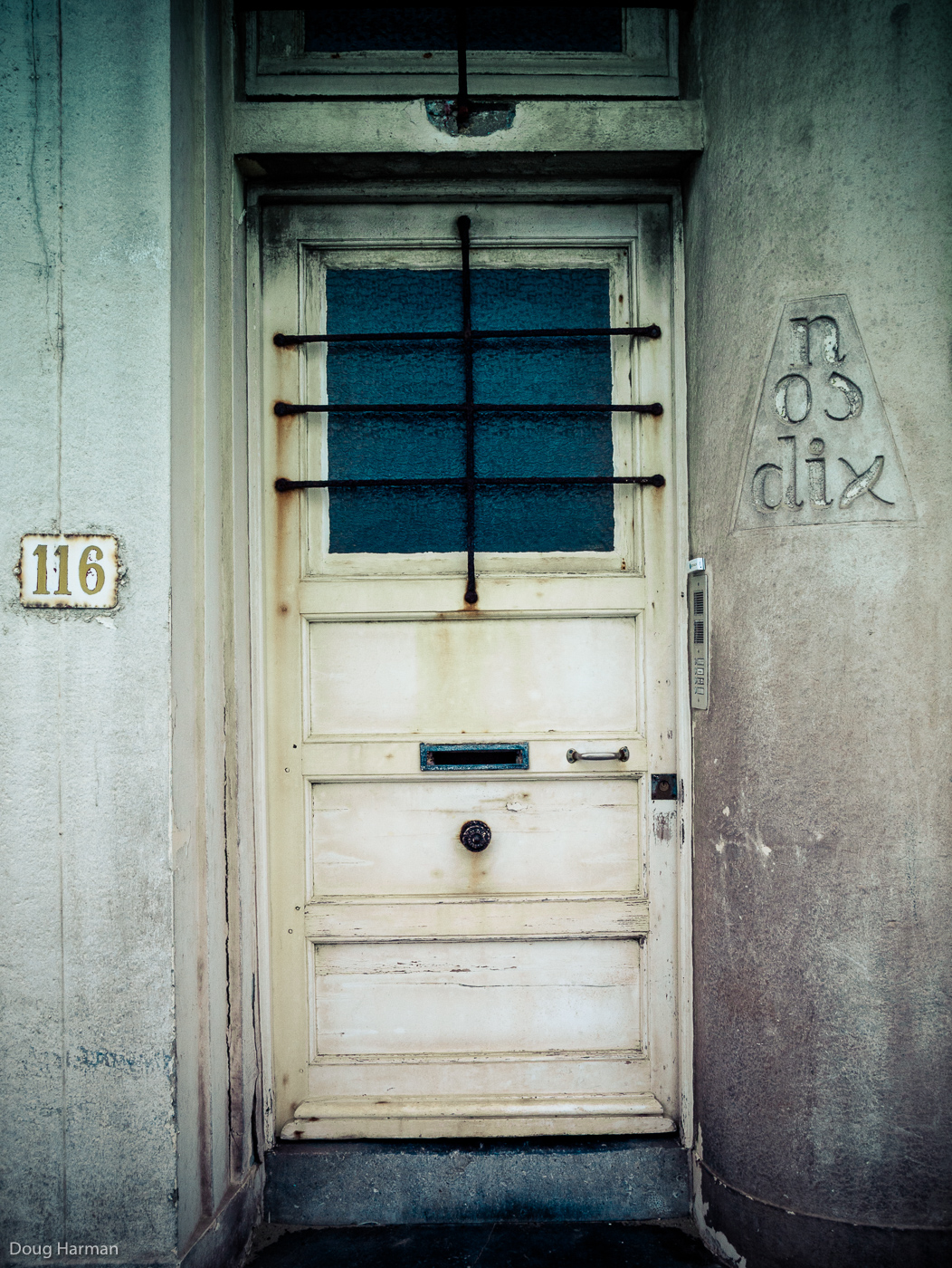One Hundred and Sixteen. One of the doors photographed as part of my Doorways project, in Dunkirk, France.