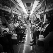 Commuters on the Tube in mono, London.
