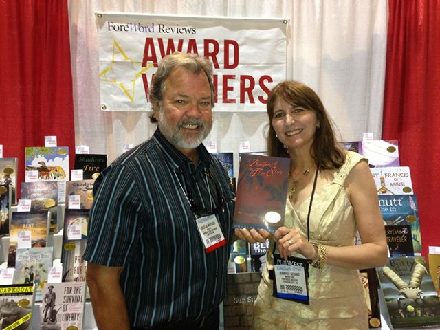 Douglas Arvidson standing with Jennifer Szunko of ForeWord Reviews